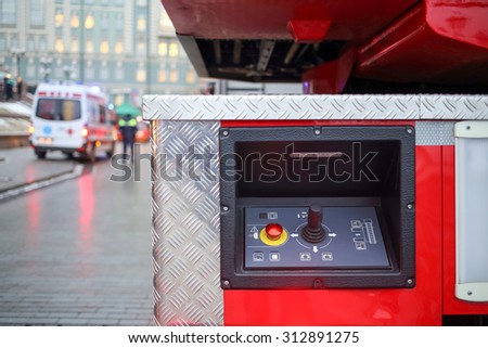fire truck ladder control panel and ambulance car - stock photo