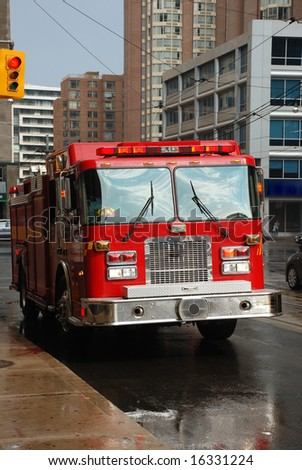 Fire truck on the city street - stock photo