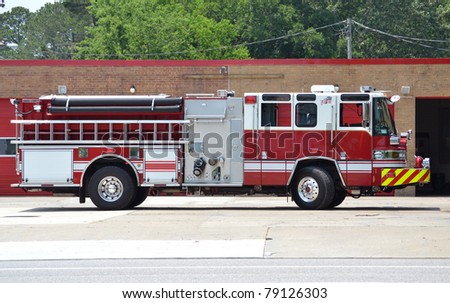 fire truck parked at a fire station - stock photo