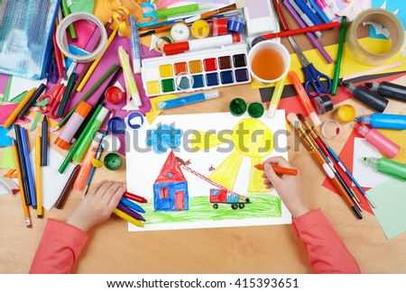 fire truck rescue cat from roof house child drawing, top view hands with pencil painting picture on paper, artwork workplace - stock photo