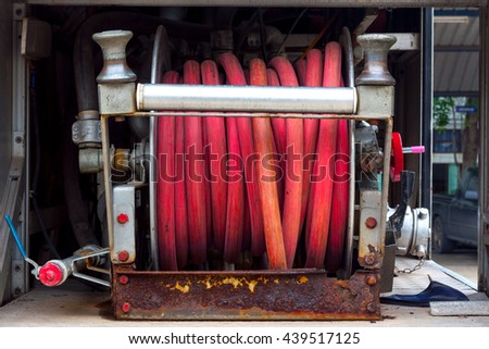 Fire truck with firehose equipment - stock photo