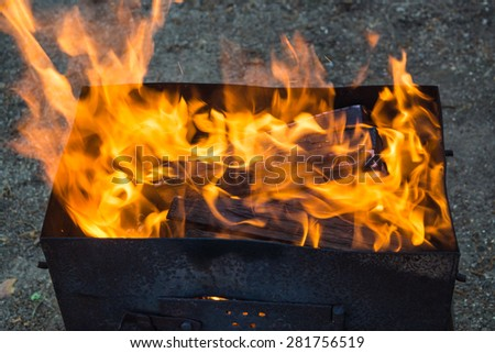 Fire with flames in a metal brazier for kebab