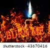 Fire with lighter in hand - stock photo