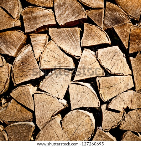 fire wood background texture. closeup of chopped fire wood stack - stock photo