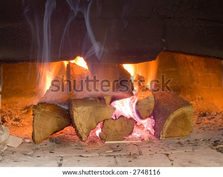 Fire wood burn in the furnace a bright flame - stock photo
