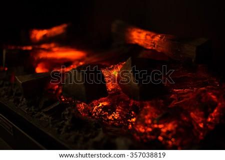 Fire wood coal amber ash closeup. Fireplace. - stock photo