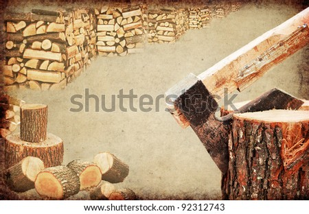 Fire wood concept.Close detail of an old and rusty axe chopping wooden log - stock photo