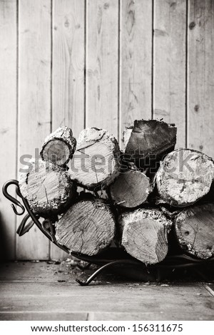 Fire wood.  Home living concept. Black and white - stock photo