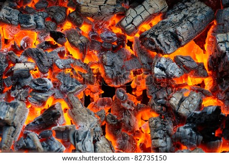 Fire woods and hot coal in a grill - stock photo