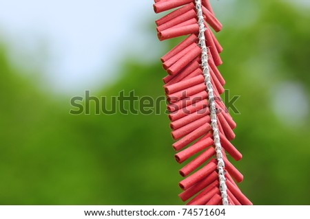 Firecrackers lay on green background - stock photo