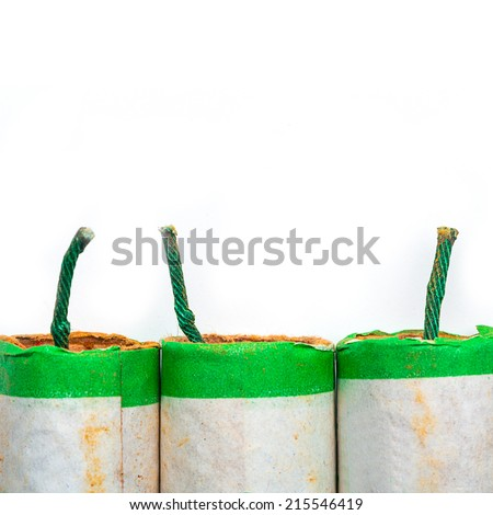 firecrackers on white background - stock photo