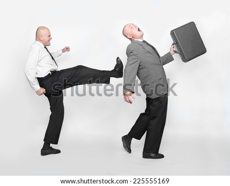Fired businessman and angry boss. Funny picture from office.  - stock photo