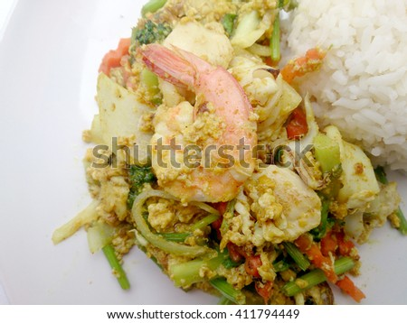 fired curry shrimp and squid, mix seafood with mix vegetable. Phat phong kari in Thai, Thai Food. - stock photo