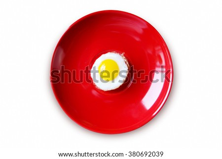 fired egg is on Red dish isolated on white background. - stock photo