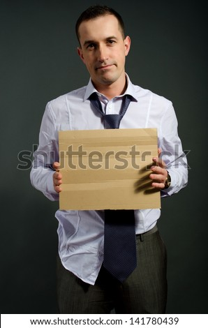 fired employee holding empty sign in hand - stock photo