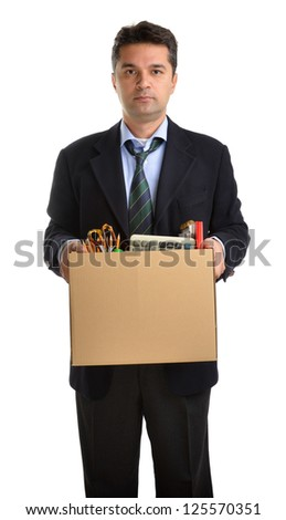 Fired man employee hiding behind box with personal items - stock photo