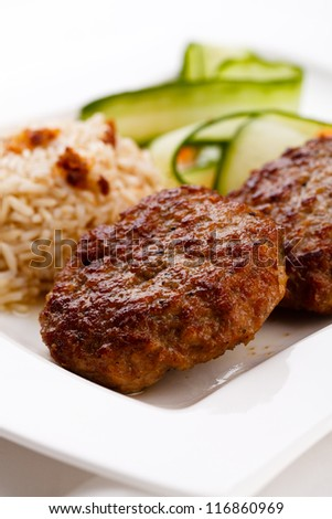 Fired meat, white rice and vegetables