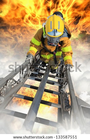 Firefighter ascends upon a one hundred foot ladder. - stock photo