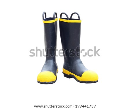 Firefighter boots through the use of fireman in Thailand on white background - stock photo