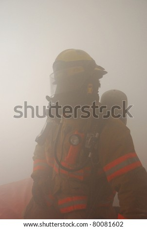 Firefighter entrapment drill and Rapid Intervention Rescue Team RIT notification drill - stock photo