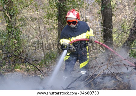 firefighter fighting fire in smoke
