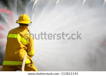 Firefighter fighting For A Fire Attack, During A Training Exercise - stock photo
