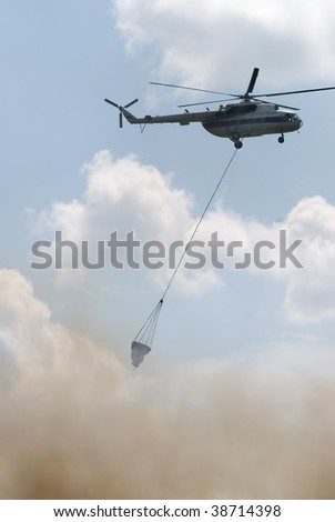 Firefighter helicopter MI-8 with water tank - stock photo