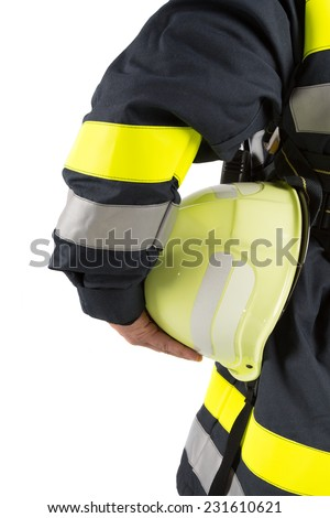 Firefighter holding helmet isolated on white - stock photo