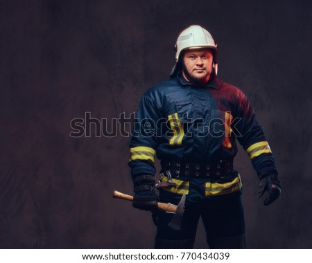 Firefighter holds the axe.