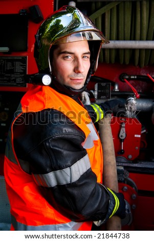 firefighter in action - stock photo