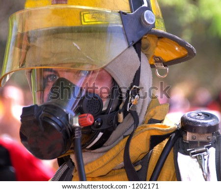 Firefighter in protective gear - stock photo