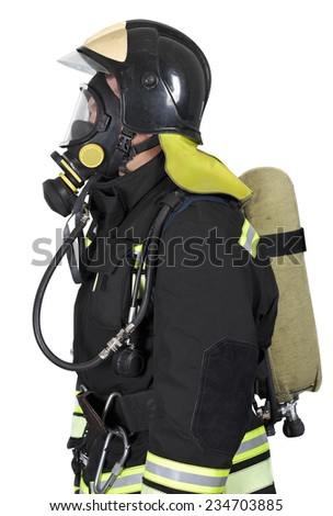 Firefighter in self contained breathing apparatus on a white background - stock photo