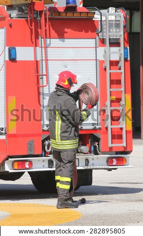 Firefighter lifted the Red hose after put off the fire