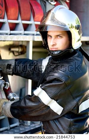 firefighter on truck - stock photo
