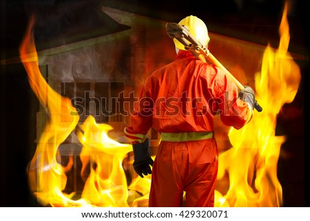 Firefighter prepared rescued the victims from the house fire  - stock photo