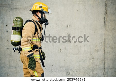 Firefighter running with all their gear  - stock photo