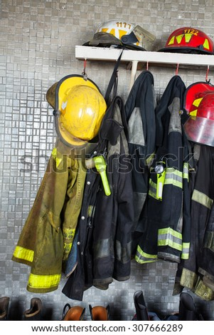Firefighter suits and equipment arranged at fire station - stock photo
