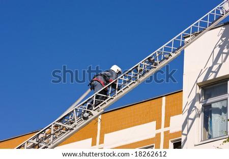 Firefighter walks upstairs - stock photo
