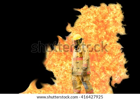 Firefighter with flame backside on black background - stock photo