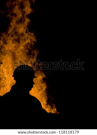 firefighter with flames - stock photo