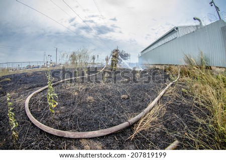 Firefighter work on the fire - stock photo