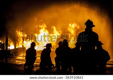 Firefighters assessing structural fire - stock photo