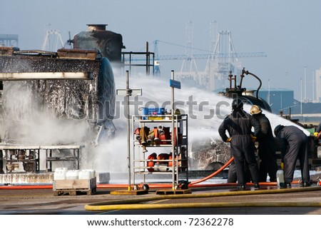Firefighters at a training exercise in the docks of Rotterdam - stock photo