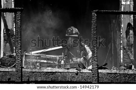 firefighters battle blaze - stock photo