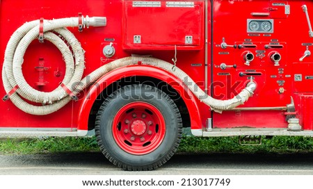 Firefighters car equipment park beside the road. - stock photo