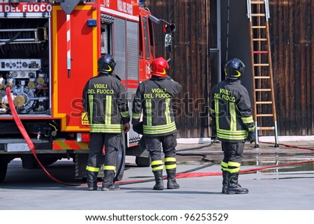 firefighters during a training exercise in their fire station - stock photo