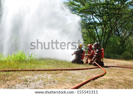 Firefighters during training  - stock photo