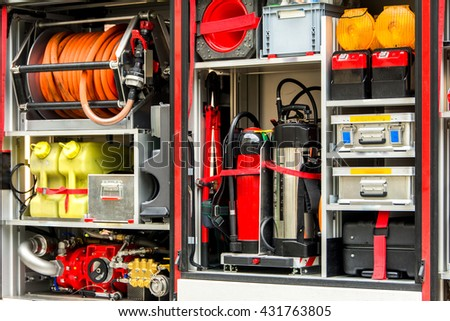 Firefighters equipment in a fire truck - stock photo