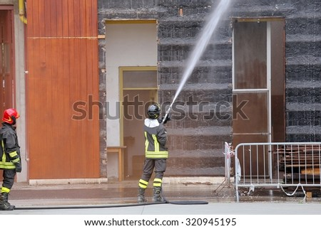 Firefighters extinguished the fire in the building during practice in the fire station - stock photo