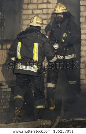 Firefighters extinguishing fire